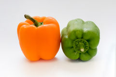 Capsicum or sweet pepper on white background. Orange and green capsicum or sweet pepper on white background Royalty Free Stock Image