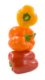 Capsicum Tower. Stack of fresh brightly colored capsicum isolated on a white background royalty free stock image