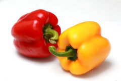 Capsicums. Red and yellow capsicum isolated on white stock images