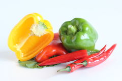 Capsicums on white stock images