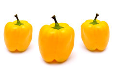 Capsicums Yellow on white Royalty Free Stock Photography