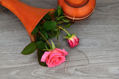 Capsize flower vase with roses. Water leaked out of a vase. Rose stock photos