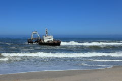 Capsized shipwreck on the Skeleton Coast in Namibia Royalty Free Stock Photography