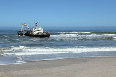 Capsized shipwreck on the Skeleton Coast in Namibia Stock Image