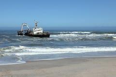 Capsized shipwreck on the Skeleton Coast in Namibia. A Capsized shipwreck on the Skeleton Coast in Namibia stock image