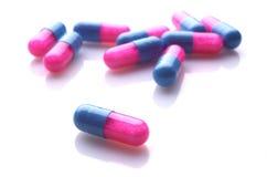 Capslules azuis e cor-de-rosa Imagem de Stock