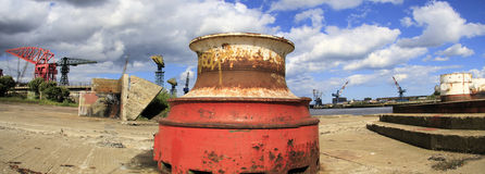 Capstan on the River Tyne. An old Capstan at a disused Dry dock at Wallsend on the River Tyne. To the left is what remains of Swan Hunter shipyard, and over the Stock Photo