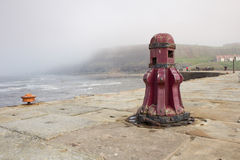 Capstan on Whitby pier. Old wooden capstan on Whitby pier stock photography