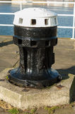 Capstans on harbour wall Royalty Free Stock Photography