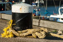 Capstans on harbour wall Stock Image