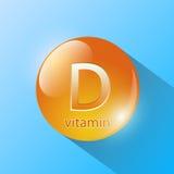 Capsula blu con la vitamina D Fotografia Stock Libera da Diritti