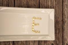 Capsula di gel dell'oro della vitamina E Immagini Stock Libere da Diritti