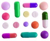 Capsula multicolore della pillola isolata su fondo bianco Vista superiore Disposizione piana Insieme o raccolta Fotografia Stock