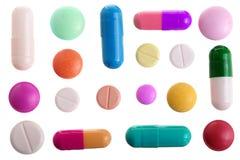 Capsula multicolore della pillola isolata su fondo bianco Vista superiore Disposizione piana Insieme o raccolta Fotografia Stock Libera da Diritti
