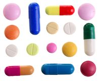 Capsula multicolore della pillola isolata su fondo bianco Vista superiore Disposizione piana Insieme o raccolta Immagini Stock Libere da Diritti
