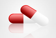 Capsule. Red and white  capsules over white background Stock Images
