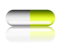 Capsule. Green and white  capsule over white background Royalty Free Stock Photo