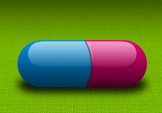 Capsule. A cyan magenta Capsule on Green background Stock Photography