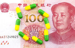 Capsule on the background of renminbi Stock Photo