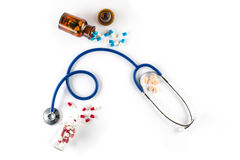 Capsule in bottle with Stethoscope and pill cardiology Stock Images