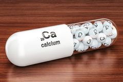 Capsule with Calcium Ca element on the wooden table. 3D renderin. Capsule with Calcium Ca element on the wooden table. 3D Royalty Free Stock Image