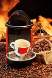 Capsule Coffee machine with  espresso cup near fireplace Royalty Free Stock Photography