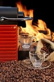 Capsule Coffee machine with two espresso cups near fireplace Royalty Free Stock Photo