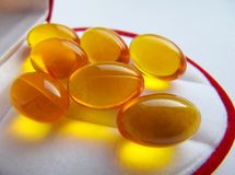 Capsule dell'olio di pesce Omega-3 Fotografie Stock