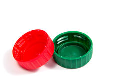 Capsule di plastica variopinte isolate su bianco Immagini Stock Libere da Diritti