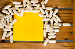 Capsule drug with blank note Stock Images