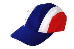 Capsule el sombrero con el modelo tailandés de la bandera aislado en blanco Imagen de archivo libre de regalías