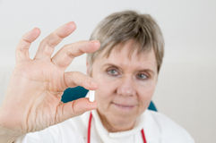 Capsule between fingers near Stock Images