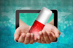 Capsule on hand pushing out of tablet Stock Photography