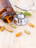 Capsule of herbal medicine alternative healthy care with stethos Royalty Free Stock Photo