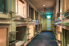Capsule Hotel. Rows of capsules at a capsule hotel in Osaka, Japan stock photo