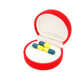 Capsule in luxury jewelry gift box Stock Photography