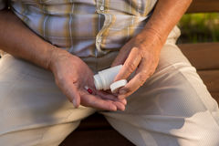 Capsule in palm of hand. White pill bottle. Don't increase the dose. Use medicine against pain Stock Photo