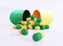 Capsule pills, dosage. 3d rendered illustration of green and yellow capsule pills on white background Stock Photography