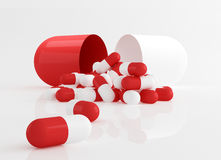 Capsule pills, dosage. 3d rendered illustration of red and white capsule pills on white background Stock Images
