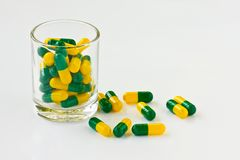 Capsule pills in a glass Royalty Free Stock Image