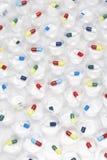Capsule pills in plastic cups Stock Images