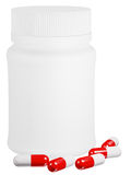 Capsule pills and white plastic bottle. Royalty Free Stock Images