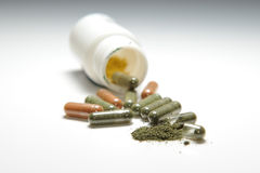Capsule And Powder. A Bottle Of Capsule,medicinal powder Leak Out Royalty Free Stock Images