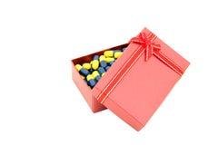 Capsule in red gift box Stock Image