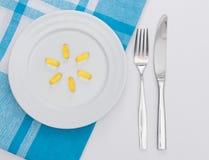 Capsule sul piatto bianco Immagine Stock