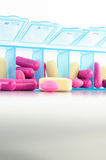 Capsule and tablet in daily pill box. Show medical concept Royalty Free Stock Image