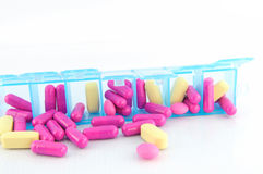 Capsule and tablet in daily pill box Royalty Free Stock Image