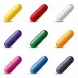 Capsule variopinte della pillola Illustrazione di vettore Fotografia Stock