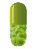 Capsule verte avec des pommes Images libres de droits