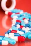 capsules пестротканое Стоковое Изображение